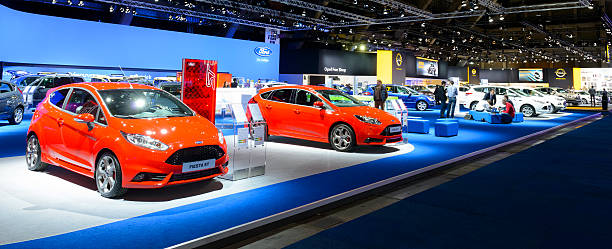 ford and opel stands - ford focus stock photos and pictures