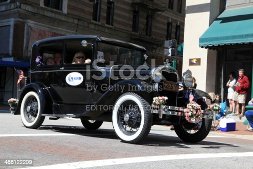 Norfolk, Va. USA - April 26, 2014: In Norfolk, Virginia during the NATO parade route the Ford car club participate with their vintage Ford vehicles while the spectators look on.