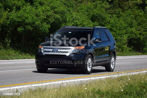 Cancun, Mexico - 11 January, 2018: Fifth generation of Ford Explorer (2010-2016) driving on the road. Assembly of the fifth-generation Explorer moved to Ford's Chicago Assembly plant, where it was built alongside the Ford Taurus and Lincoln MKS.