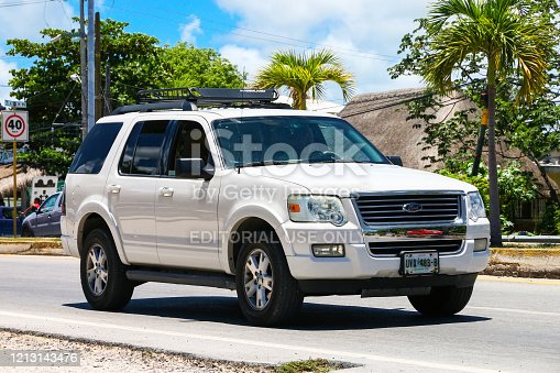 Tulum, Mexico - May 17, 2017: White SUV car Ford Explorer in the city street.