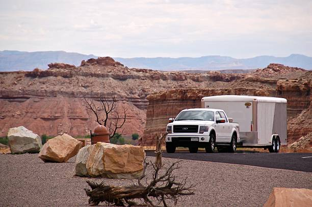 Ford F-150 EcoBoost parked with trailer Green River, United States - September 7th 2014. 2014 model year Ford F-150 with a trailer parked at a rest stop along Interstate 70.  vehicle trailer stock pictures, royalty-free photos & images