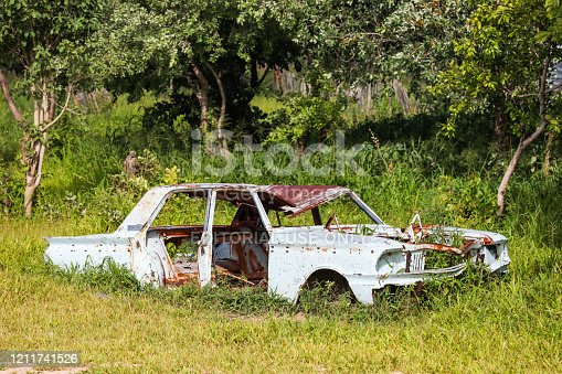 Rundu, Namibia - February 8, 2020: Remains of the old saloon car Ford Fairlane at the roadside.