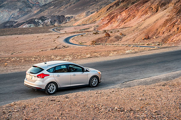 ford focus in death valley national park california - ford focus stock photos and pictures