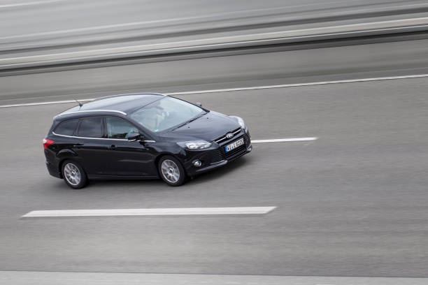 ford focus on german motorway a3 - ford focus stock photos and pictures