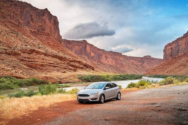 ford focus on utah route 128 scenic byway near moab utah usa - ford focus stock photos and pictures