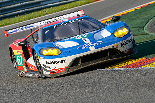 Ford GT Chip Ganassi Racing race car Spa, Belgium - May 7, 2016: Ford Chip Ganassi Racing Ford GT race car driving in Les Combes. The car is driving around the Spa Francorchamps race track during the WEC 6 Hours of Spa-Francorchamps. The team participates in the 2016 FIA World Endurance Championship (WEC). spa belgium stock pictures, royalty-free photos & images