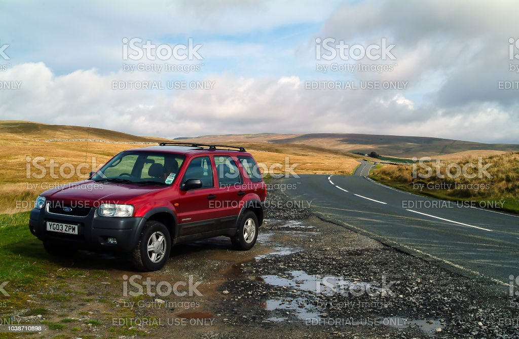 A Ford Maverick 4x4 car parked off road in the hills of the Yorkshire Dales stock photo