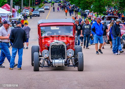 Moncton, New Brunswick, Canada - July 9, 2016 : 1929 Ford Model A entering Centennial Park during 2016 Atlantic Nationals, Moncton, New Brunswick, Canada.  People entering the park walk near the hot rod.
