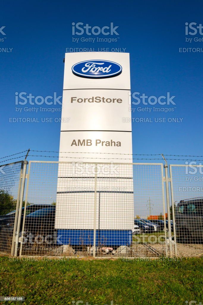 Ford motor company logo on dealership building stock photo
