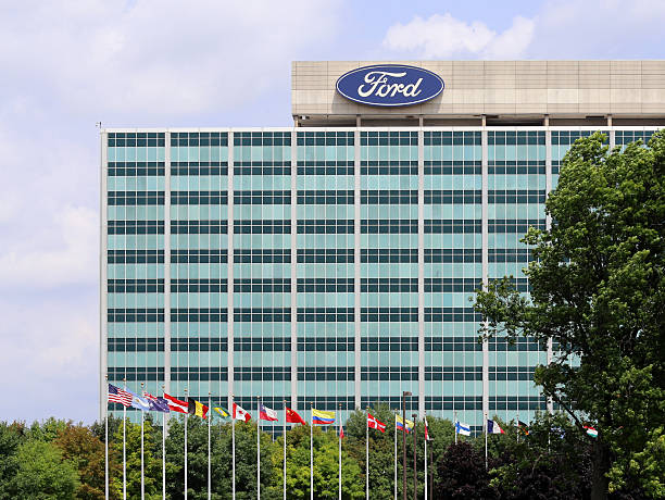 Ford Motor Company World Headquarters Dearborn, MI, USA – July 31, 2014: The Ford Motor Company World Headquarters building located in Dearborn, Michigan. Ford Motor Company is an American multinational automobile corporation. vehicle brand name stock pictures, royalty-free photos & images
