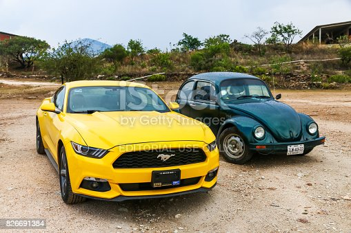 Hierve El Agua, Mexico - May 26, 2017: Motor cars Ford Mustang and Volkswagen Beetle at the countryside.