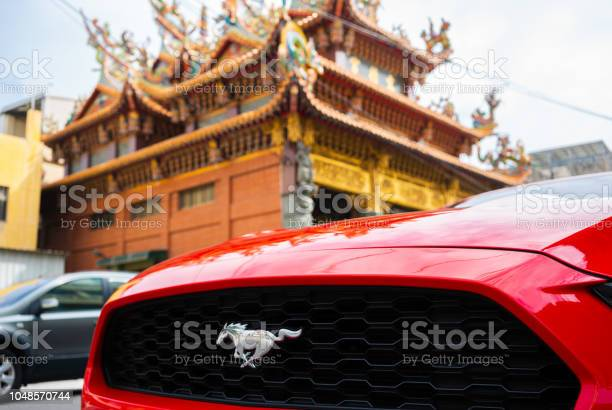 Ford mustang car grille and logo with temple background picture id1048570744?b=1&k=6&m=1048570744&s=612x612&h=9eoxdnml6gduxhbkrmwmeopjswqxw8o9yalsxlgqo98=