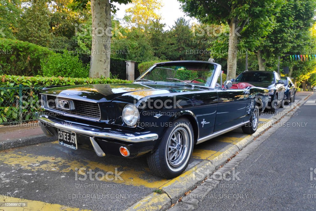 Ford Mustang convertible Chantilly, France - July 18 2020: Ford Mustang convertible parked in the street. 1966 Stock Photo