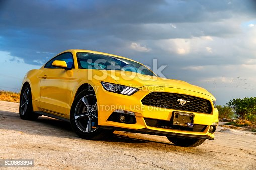 Campeche, Mexico - May 20, 2017: Yellow muscle car Ford Mustang at the countryside.