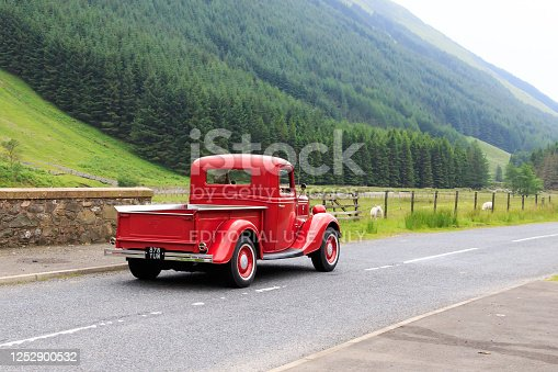 Moffat, Scotland - June 29, 2019: 1937 Ford V8 Deluxe pick up truck in a classic car rally en route towards the town of Moffat, Dumfries and Galloway