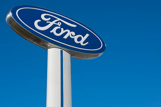 Ford knoxville, tn usa - february 25, 2012: Ford sign at Ford dealership in knoxville, tn usa.  vehicle brand name stock pictures, royalty-free photos & images