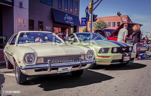 Moncton, New Brunswick, Canada - July 7, 2017 : 1971 Ford Pinto & 2005 Mustang GT convertible parked in the downtown area of Moncton during 2017 Atlantic Nationals Automotive Extravaganza.