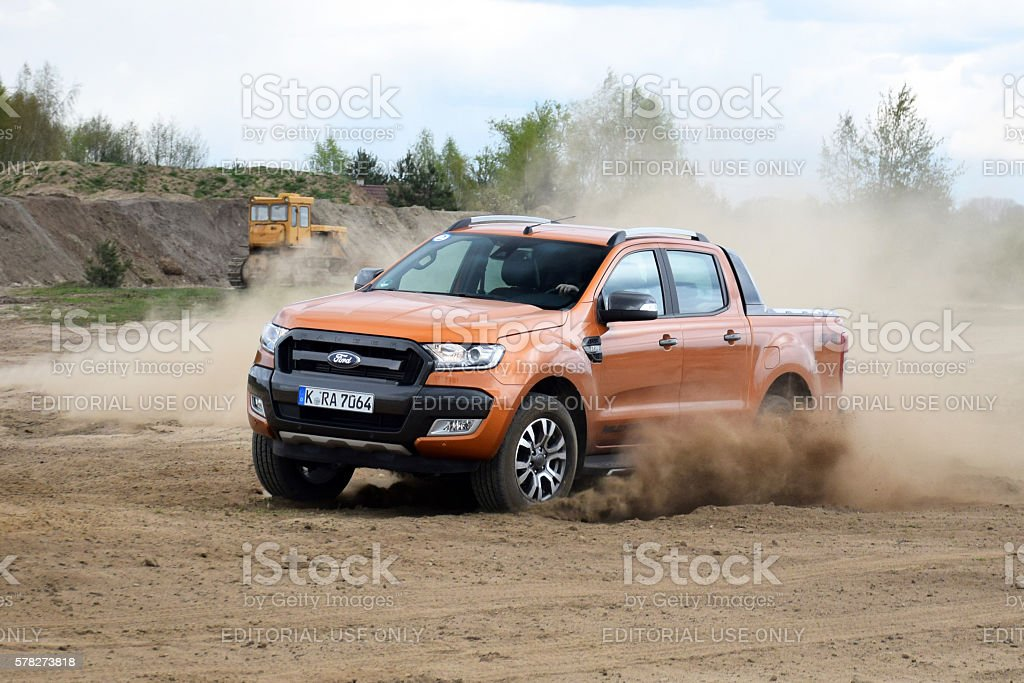 Ford Ranger driving on the unmade road stock photo