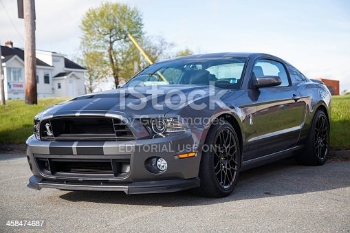 Dartmouth, Nova Scotia, Canada - May 30, 2013: A Ford Shelby GT500 in a parking lot.  At this public car gathering many models of both classic and modern cars gather.  First available in 1965 the Shelby Mustang became a performance icon.  After 1970, the Shelby did not become available until 2007 when it was reintroduced.