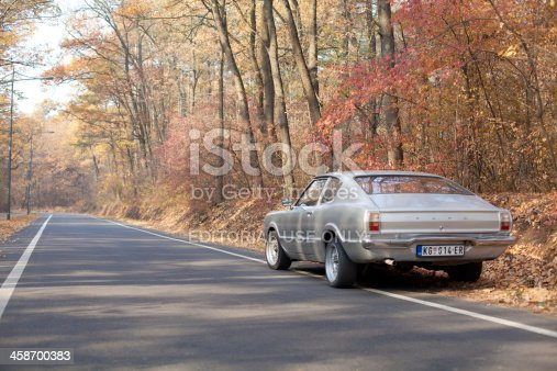 Kragujevac, Serbia - November 17, 2011: Ford Taunus Coupe 1.6 1972 parked in the autumn forest of the city park.This car was developed under the auspices of Ford of Europe and produced in the TC generation from1970 to 1976 year and developed with 2-door coupe body type, RWD (rear-wheel drive) and manual 4-speed gearbox. Petrol (gasoline) engine of 1593 cm3 / 97.2 cui displacement with advertised power 53 kW / 71 hp. Ford Taunus remains a popular car among automobile enthusiasts till today