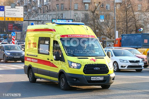Moscow, Russia - April 19, 2019: Yellow ambulance car Ford Transit in the city street.
