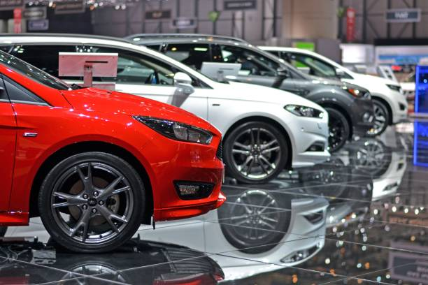 ford vehicles on the exposition in a row - ford focus stock photos and pictures