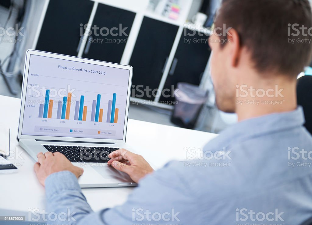 Forecasting the financial future of his business stock photo