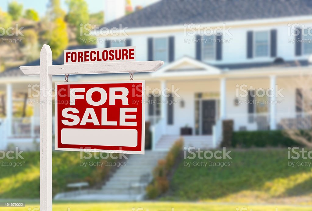 Foreclosure Home For Sale Sign in Front of Large House stock photo