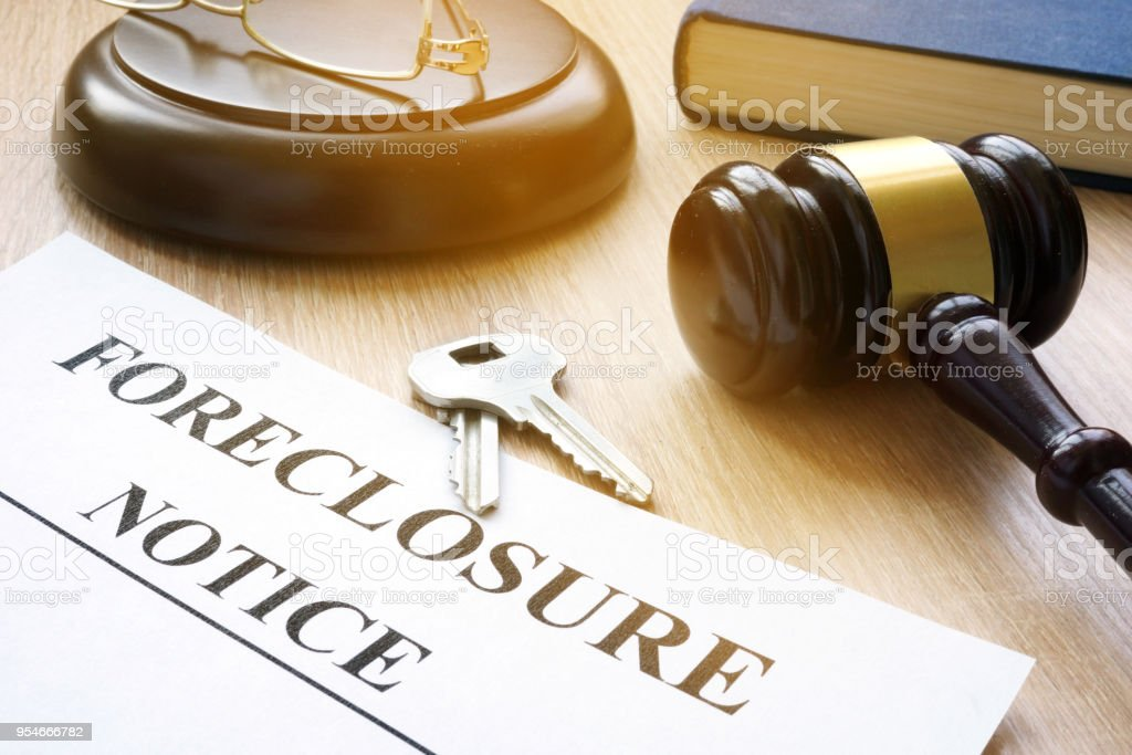 Foreclosure notice and keys on a court table. stock photo