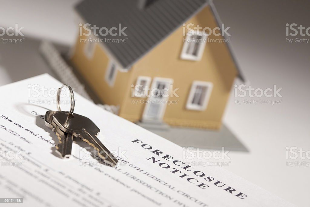 Foreclosure Notice, House Keys and Model Home on Gradated Background royalty-free stock photo