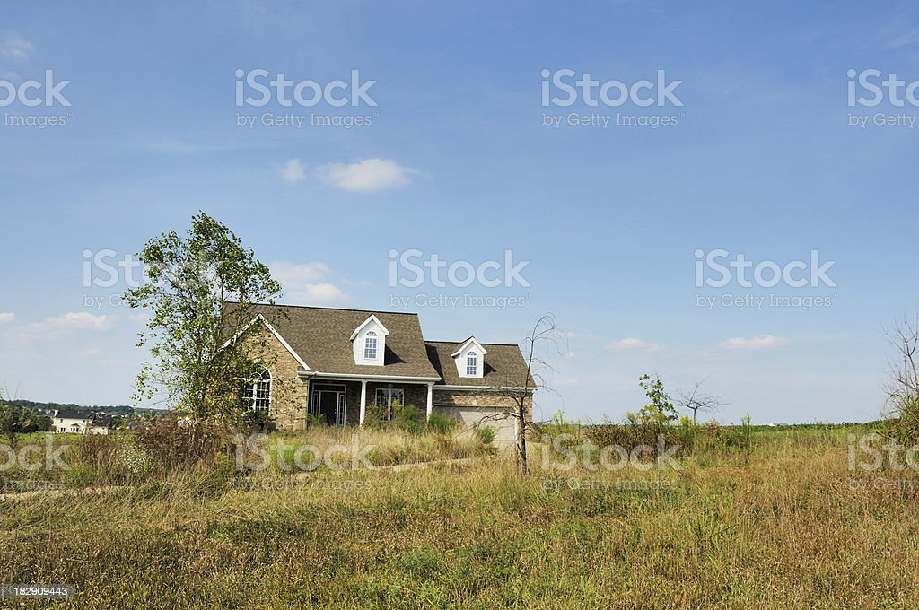 Foreclosure Overgrown Modern American Home stock photo