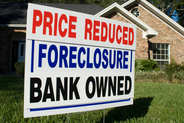 Foreclosure, Price Reduced, Bank Owned Yard Sign stock photo