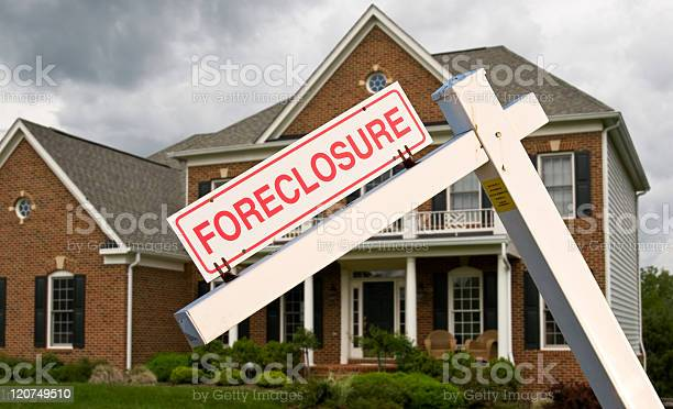Foreclosure Sign In Front On Modern House Stock Photo - Download Image Now