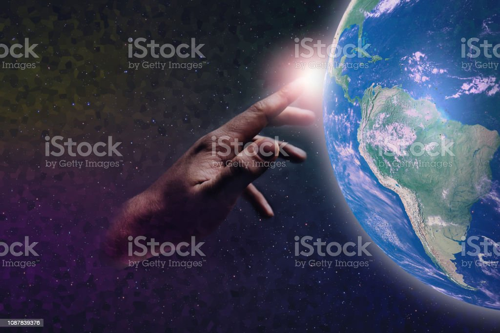 Forefinger touches a earth pixel in infinite space. Mixed Media. Concept matrix universe. stock photo