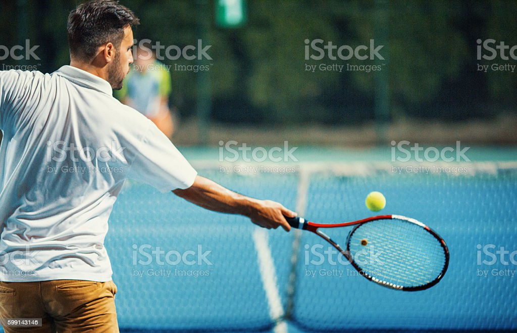 Forehand at a tennis game. stock photo