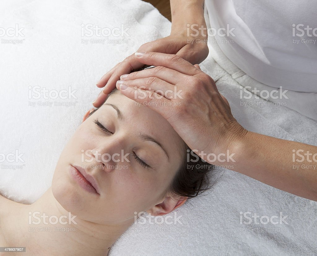 forehead massage to remove headache royalty-free stock photo