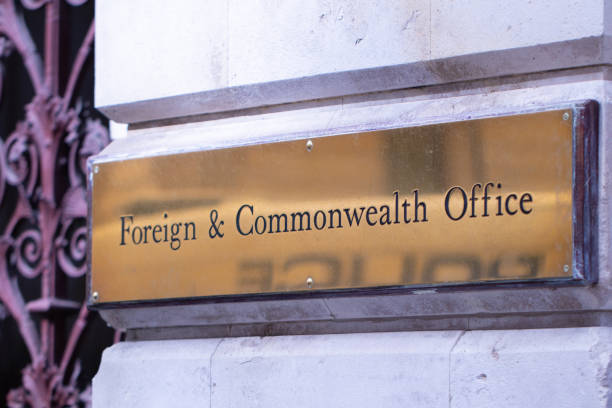 Foreign & Commonwealth brass plaque outside the offices in Westminster, London Foreign & Commonwealth brass plaque outside the offices in Westminster, London foreign affairs stock pictures, royalty-free photos & images
