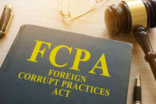fcpa foreign corrupt practices act on a desk. - corruption imagens e fotografias de stock
