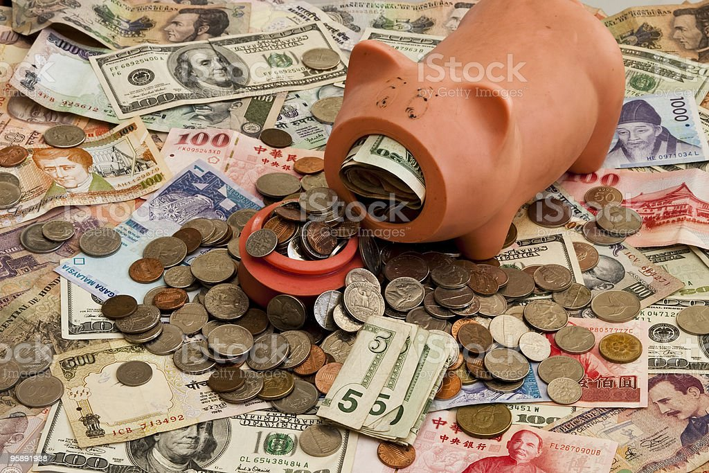 Foreign Currency and Piggy Bank stock photo