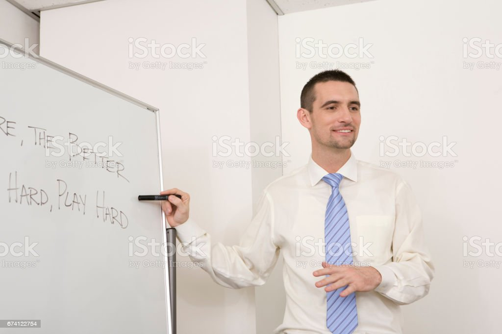 Foreign instructors teaching English conversation royalty-free stock photo
