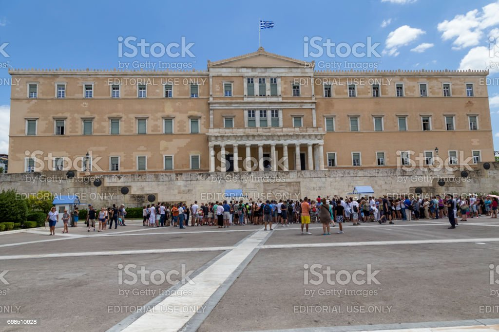 Foreign tourists in front of the Greek Parliament building stock photo