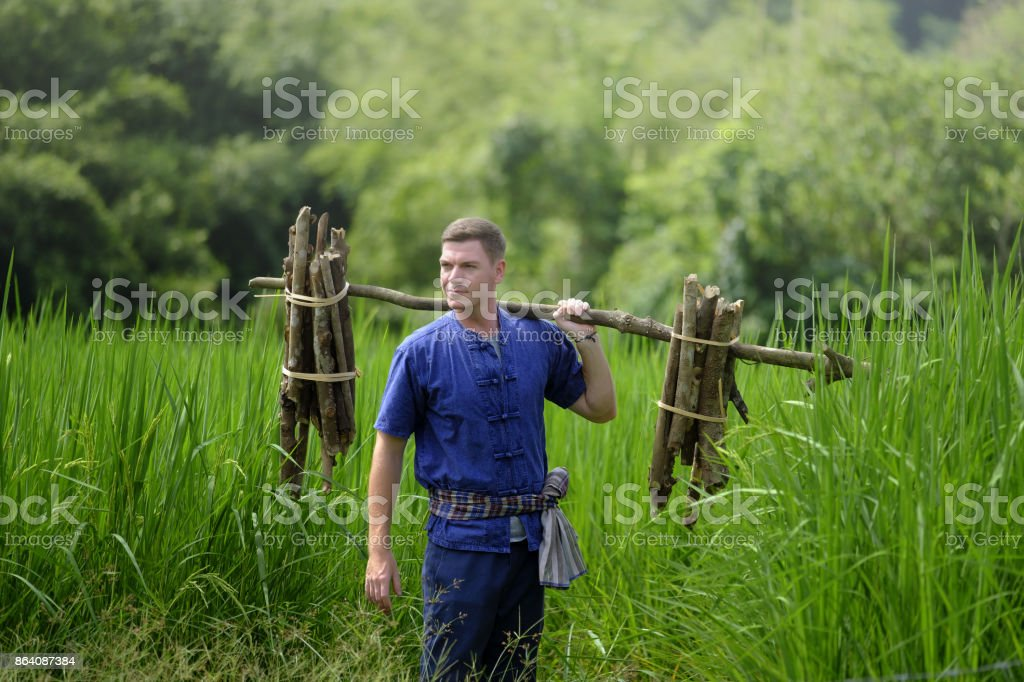 Foreign tourists in Thailand, traditional Thai dress farmer back to nature life concept royalty-free stock photo