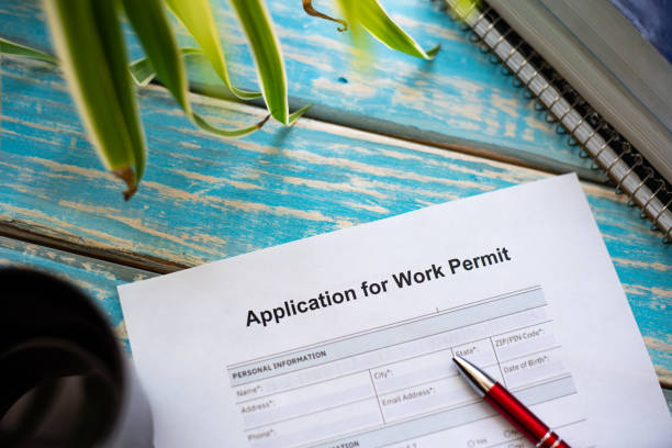 Foreign worker applying for work permit stock photo