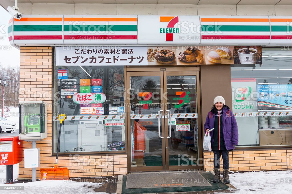 Foreigner Standing Outside 7-11 Convenience Store in Niseko stock photo