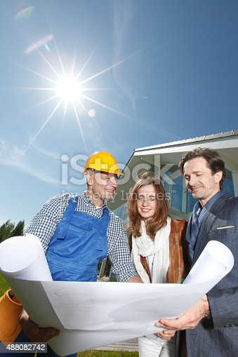 istock foreman and a young couple 488082742
