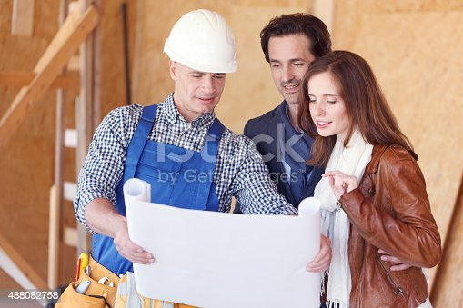 istock foreman and a young couple 488082758