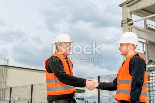 1055059750istockphoto Foreman and construction worker shaking hands 478011451