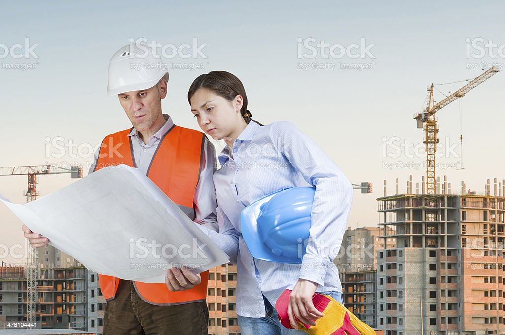 Foreman and engineer with blueprints royalty-free stock photo