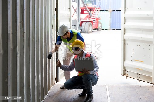 Foreman and staff are opening containers to check stock. Logistics engineer control at the port.