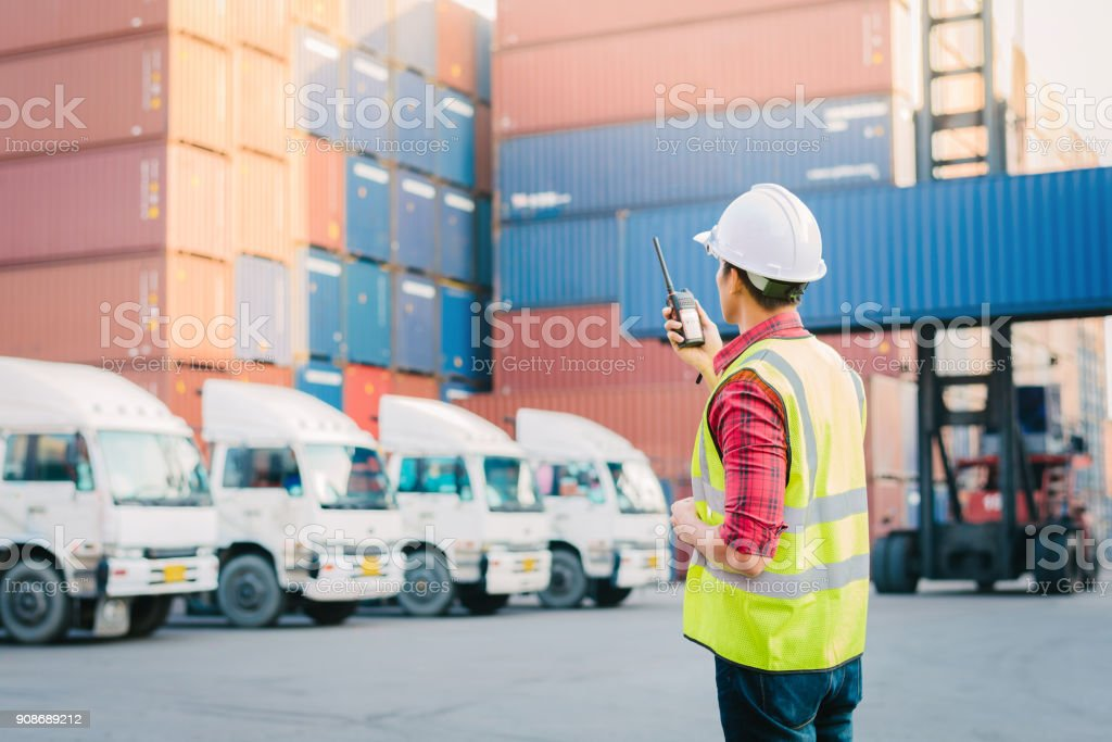 foreman control loading Containers box for Logistic Asian foreman control loading Containers box for Logistic Import Export in dock Adult Stock Photo